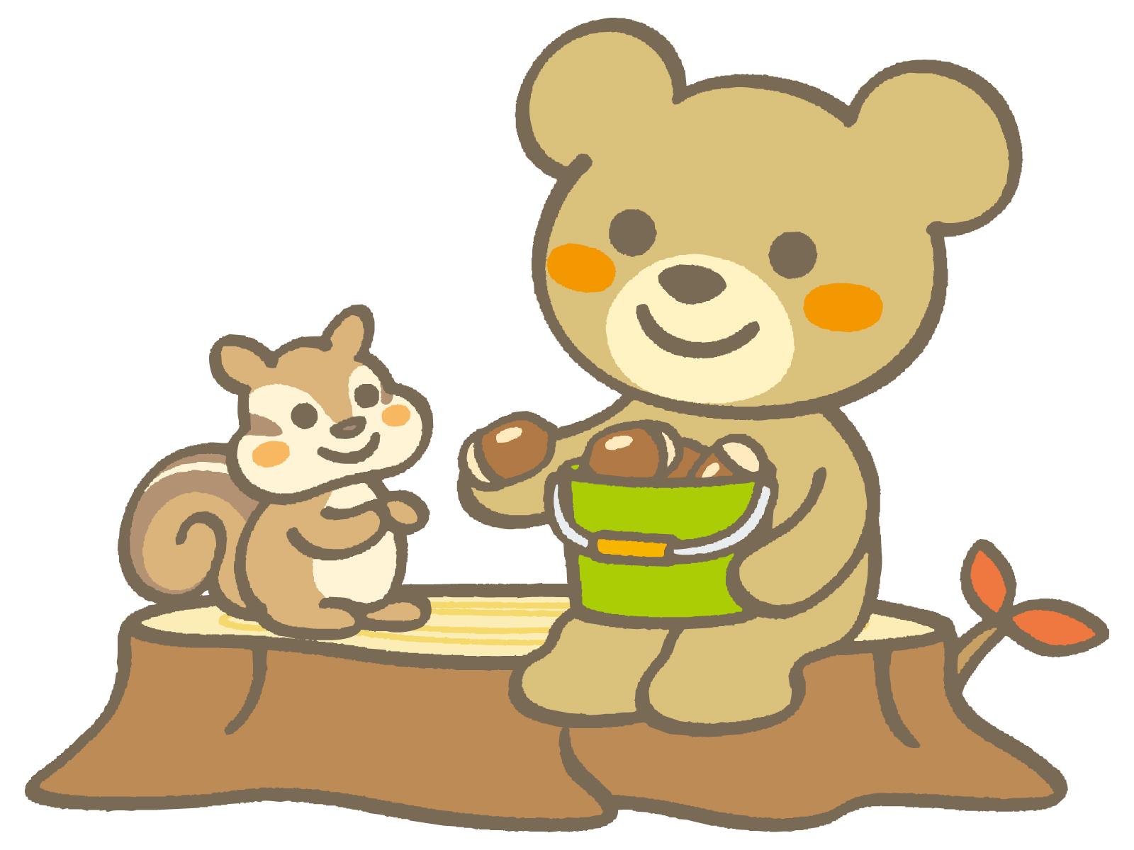 木の実をおすそ分けしている熊
